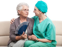 Old woman heatstroke helped by nurse or doctor Royalty Free Stock Images