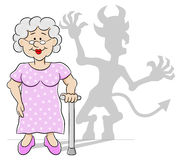Old woman with her devil shadow Stock Photos