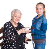 Old woman with her granddaughter Stock Images