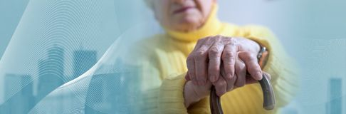 Old woman with her hands on a cane. panoramic banner royalty free stock photo