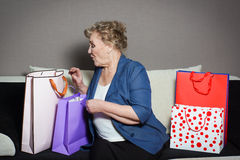 Old woman with her shopping. An old woman with her shopping Royalty Free Stock Images