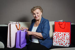 Old woman with her shopping. An old woman with her shopping Stock Photos