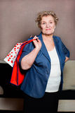 Old woman with her shopping. An old woman with her shopping Royalty Free Stock Photo