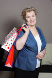 Old woman with her shopping. An old woman with her shopping Royalty Free Stock Image
