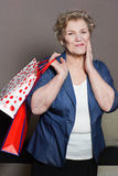 Old woman with her shopping. An old woman with her shopping Stock Photography
