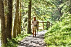 OLD WOMAN ON HIKING TRAIL stock photography