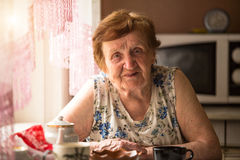 Old woman at his home. Royalty Free Stock Photography