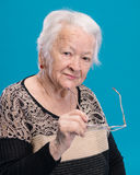 Old woman holding glasses Stock Photos