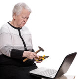 Old woman with holding hammer and pliers Royalty Free Stock Images