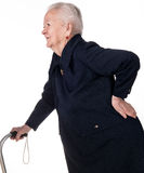 Old woman holding her lower back Stock Photography