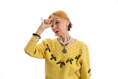 Old woman holding medicine. Stock Image