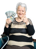 Old woman holding money in hands Royalty Free Stock Photo