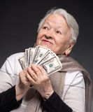 Old woman holding money in hands Stock Photography