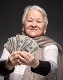 Old woman holding money in hands Royalty Free Stock Photos