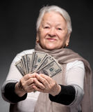 Old woman holding money in hands Stock Photo
