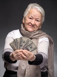Old woman holding money in hands Stock Images