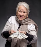 Old woman holding money in hands Stock Image