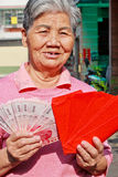 Old woman holding  New Year's money Royalty Free Stock Photos