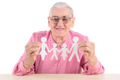 Old woman holding  paper family Stock Photo