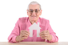 Old woman holding  paper house Stock Image