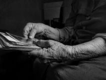 Old woman holding picture in hand stock photos