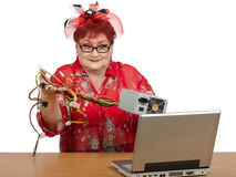 Old woman holding power supply Stock Photos