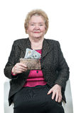 Old woman holding wallet with money Stock Photos