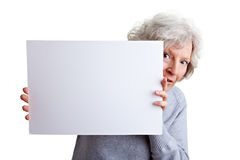 Old woman holding white poster Stock Photo