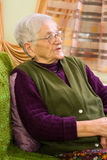 Old woman at home Royalty Free Stock Image
