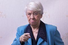Old woman at home. Angry Royalty Free Stock Image