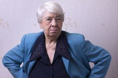 Old woman at home. Angry Royalty Free Stock Images