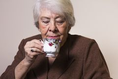 Old woman at home. With cup of tea Stock Photo