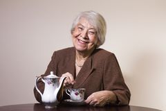 Old woman at home. With a cup of tea Royalty Free Stock Image