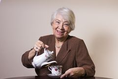 Old woman at home. With a cup of tea Stock Photos