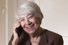 Old woman at home smiling Royalty Free Stock Photography