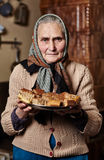 Old woman with homemade cookies Royalty Free Stock Photography
