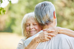 Old woman hugging an old man Royalty Free Stock Photo