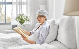 Free Old Woman In Glasses Reading Book In Bed At Home Royalty Free Stock Photo - 221365425