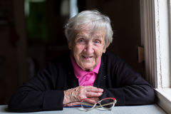 Free Old Woman In Her Home, Looking Into The Camera. Happy. Royalty Free Stock Photo - 83113745