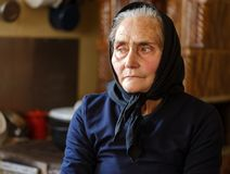 Old woman indoor. Old peasant woman in her house Royalty Free Stock Photos
