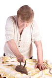 The old woman irons a cloth Stock Photo