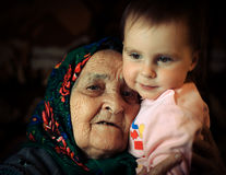Old woman with a kid Stock Images