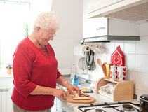 old woman in the kitchen Stock Images