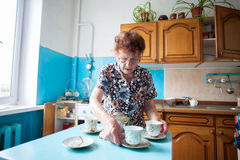 Old woman on the kitchen Stock Photo