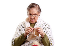 Old woman knits Royalty Free Stock Photo