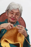 Old woman knitting. Image of an old woman knitting.Selective focus on the hands Royalty Free Stock Photography