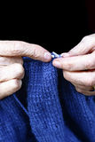 Old Woman Knitting. Close-up of an old woman's hands as she knits Stock Images
