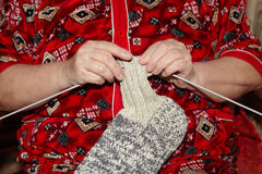 Old woman and knitting clothes Royalty Free Stock Photo