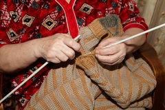 Old woman and knitting sweater. Senior people Royalty Free Stock Images