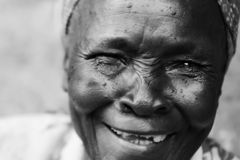 An old woman laughing with no teeth royalty free stock photo